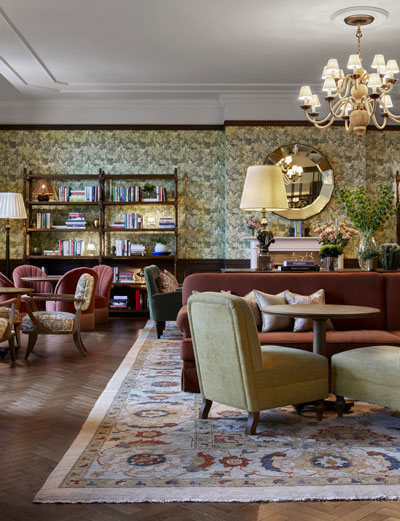 Lounge Area with sofas, chairs, tables and book shelf in the Four Seasons Hotel, Hampshire
