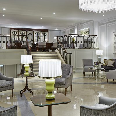 The Entrance Lobby of the London Marriott Hotel. Greys, pearls with a hint of lime green decorate this impressive entrance lobby.