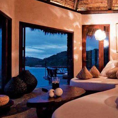 Sofas overlooking the ocean from a bedroom in the Laucala Island Resort – Fiji
