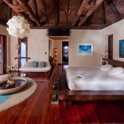 White, blue and earthy decor complete this bedroom in the Laucala Island Resort – Fiji