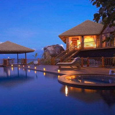Night time view of a secluded suite overlooking an infinity pool at the Laucala Island Resort – Fiji