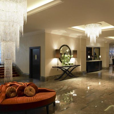 Ornate chandeliers and marble floors fill the Lobby at the Intercontinental Hotel Park Lane, London