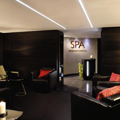 Black leather chairs surround the entrance to the Spa reception at the Intercontinental Hotel Park Lane, London