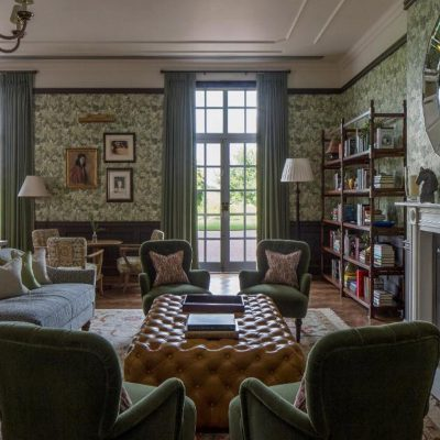 Green floral decor lounge with sofas and books in the Four Seasons Hotel, Hampshire