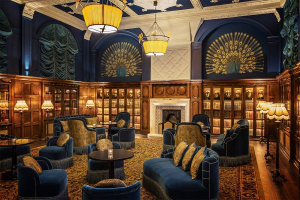 Luxury library with blue and gold decor at the L'Oscar London Hotel
