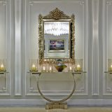 Luxury mirror lit up with candles and a chandelier