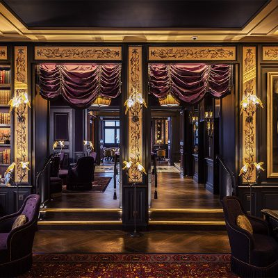Gold and Purple decor in the Library of the L'oscar London Hotel